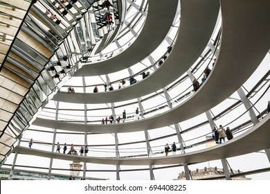 Germany, Berlin - April, 21, 2017: The glass dome of the Reichstag and the people in it in Berlin in 2017