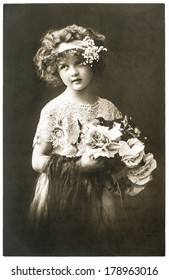 GERMANY, BERLIN - CIRCA 1918: old photo portrait of little girl with flowers. Illustrative Image, subject of human interest