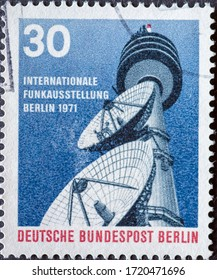 GERMANY, Berlin - CIRCA 1971: a postage stamp from Germany, Berlin showing two telescope mirrors and a radio tower Text: Internationale radio exhibition Berlin 1971