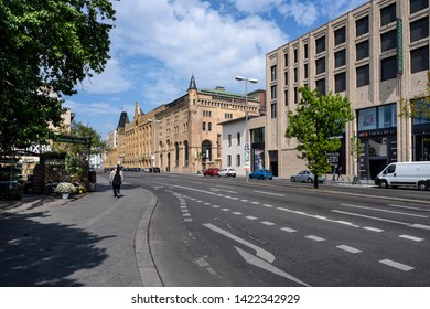 Germany, Berlin, Wedding, Moabit: Street scene with famous old renovated Schulheiss building quartier and blue cloudy sky in the German capital - concept architecture city planning. May 01, 2019