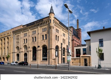 Germany, Berlin, Wedding, Moabit: Street scene with famous old renovated Schulheiss building quartier and blue cloudy sky in the center of the German capital - concept architecture. May 01, 2019