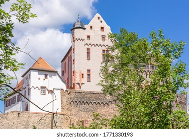 Germany, castle in Alzenau. Sights of Bavaria. Stone building. Summer in city.