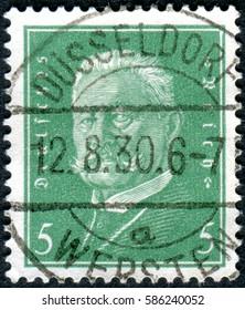 GERMANY - CIRCA 1928: A stamp printed in Germany (Deutsches Reich), shows a portrait of the President of the German Reich Paul von Hindenburg, circa 1928