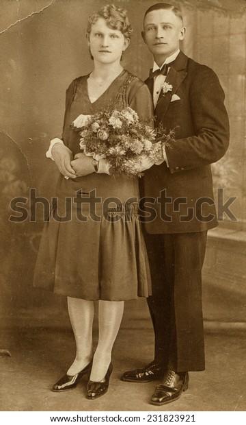 GERMANY, CIRCA 1930: Vintage photo of newlyweds