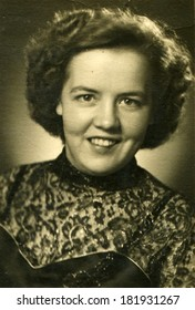 GERMANY - CIRCA 1930s: An antique studio portrait of pretty woman