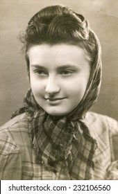 GERMANY, CIRCA 1930s: Vintage portrait of young girl in a kerchief