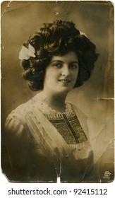GERMANY - CIRCA 1934: Reproduction of antique postcard shows beautiful woman, circa 1934