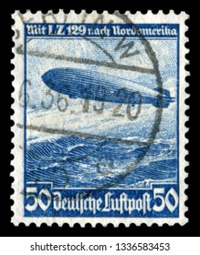"""GERMANY - CIRCA 1936: German historical stamp:  mesatlantica flights L. Z. 129 (airship """"Hindenburg"""") over the Atlantic ocean with cancellation, DR, third Reich"""