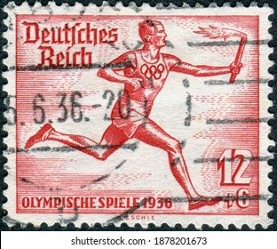 GERMANY - CIRCA 1936: Postage stamp printed in Germany, dedicated to the Summer Olympic Games in Berlin, shown a runner from the torch relay Olympic Berlin, circa 1936