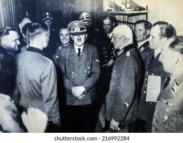 GERMANY - CIRCA 1940s: Adolf Hitler among the officers, one of whom is bandaged head. Reproduction of antique photo.