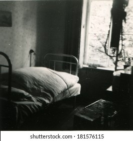 GERMANY - CIRCA 1940s: An antique photo of bed and drip near the window in a hospital ward