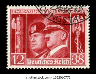 GERMANY - CIRCA 1941:  German historical stamp: German-Italian brotherhood in arms, Portraits of Hitler and Mussolini with symbols of the Nazi and fascist regime of the two countries, the Third Reich