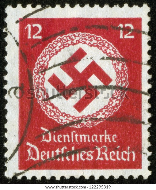 GERMANY - CIRCA 1942: A stamp printed by the fascist Germany Post shows a swastika in a garland, circa 1942