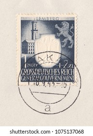 GERMANY - CIRCA 1943:A stamp printed in Deutsches Reich (General Government),shows Town hall in the city of Lemberg,Coat of arms depicting a lion.Postmark was from city Krakow, circa 1943