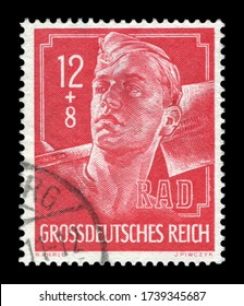 GERMANY - CIRCA 1944: German postage stamp: RAD service worker in uniform with a shovel on his shoulders, fair labor brigades, 1944, Germany, the Third Reich, ww2