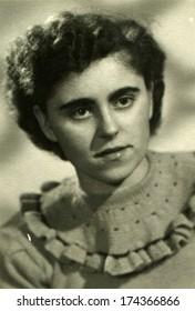 GERMANY -  CIRCA 1950s: An antique photo shows studio portrait of woman