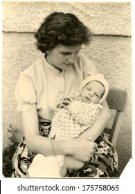 GERMANY - CIRCA 1950s: An antique photo of woman with child