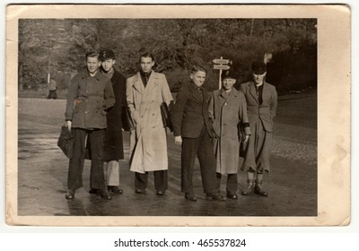 GERMANY - CIRCA 1950s: Vintage photo shows group of boys (students) go to the school. Retro black & white photography.
