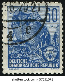 GERMANY- CIRCA 1953: stamp printed by Germany, shows Building the multi-purpose dry cargo sea-river going vessels, circa 1953.
