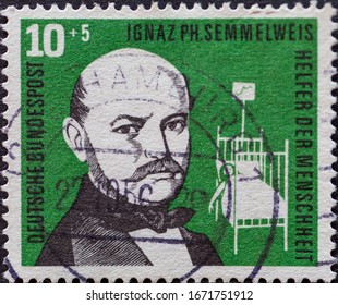GERMANY - CIRCA 1956: a charitably postage stamp printed in Germany showing a portrait of Ignaz PH Semmelweis a helper of humanity