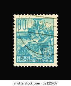GERMANY - CIRCA 1956: A stamp printed in Germany showing harvesters, circa 1956