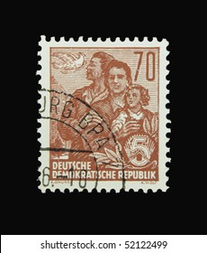 GERMANY - CIRCA 1956: A stamp printed in Germany showing family and dove, circa 1956