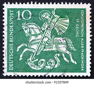 GERMANY - CIRCA 1961: a stamp printed in the Germany shows St. George Killing the Dragon, patron saint of Boy Scouts, circa 1961