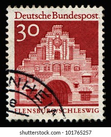 "GERMANY - CIRCA 1966: A stamp printed in Germany from the ""Historic Buildings"" issue showing Nordertor, Flensburg, circa 1966."