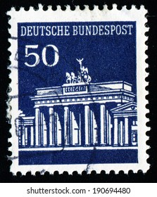 """GERMANY - CIRCA 1966: A stamp printed in Germany shows Brandenburg Gate, Berlin, with the same inscription, from the series """"Brandenburg Gate"""", circa 1966"""