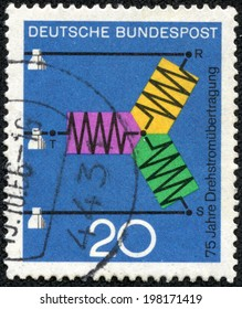 """GERMANY - CIRCA 1966: A stamp printed in Germany from the """"Scientific anniversaries (2nd series)"""" issue shows diagram of A.C. Transmission (75th anniversary), circa 1966."""
