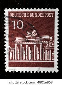 GERMANY - CIRCA 1967: A dark brown stamp of value 10 pfennigs (Scott 2008 937) shows image of the Brandenburg Gate, circa 1967
