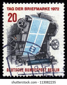 GERMANY - CIRCA 1972: a stamp printed in the Germany shows Image printing press, printing postage stamps, circa 1972