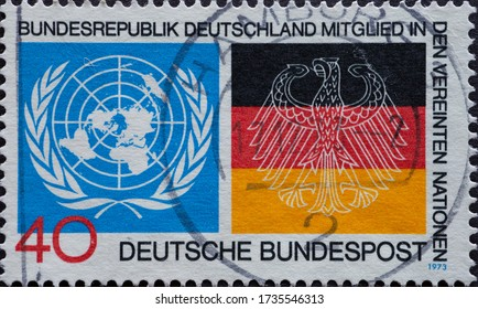 GERMANY - CIRCA 1973: a postage stamp printed in Germany showing the symbol of the united nations and flag of Germany. Text: Germany member of the United Nations