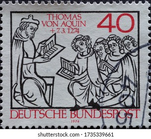 GERMANY - CIRCA 1974: a postage stamp printed in Germany showing Instruction of monks by the Dominican, philosopher and Catholic theologian Thomas Aquinas