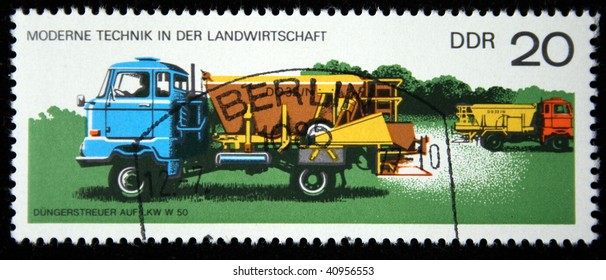 GERMANY - CIRCA 1975: A stamp printed in Germany shows Machine fertilizer LKW W 50, circa 1975.