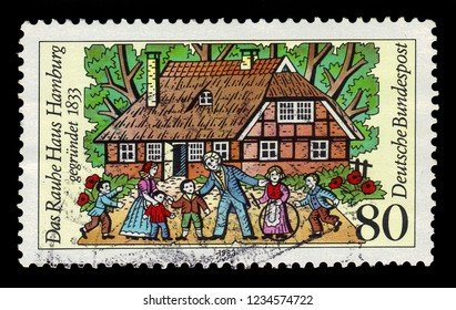 GERMANY - CIRCA 1983: postage stamp printed in Germany, shows Rauhes Haus (Children's Home) is a social service institution, founded in 1833 in Hamburg, Germany, 150th anniv, circa 1983
