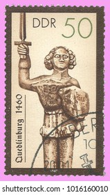 Germany - circa 1987: Stamp printed by Germany, Color edition on Sculpture, shows Historical Monument Pillars Roland in Quedlinburg, circa 1987
