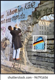 GERMANY - CIRCA 1990: A postcard printed in Germany, is dedicated to the first anniversary of the fall of the Berlin Wall, circa 1990