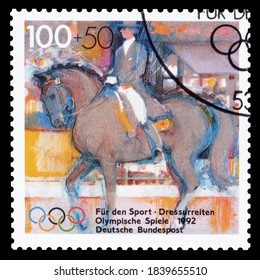 GERMANY - CIRCA 1992 : Cancelled postage stamp printed by Germany, that promotes Olympic games and shows Horse riding, circa 1992.