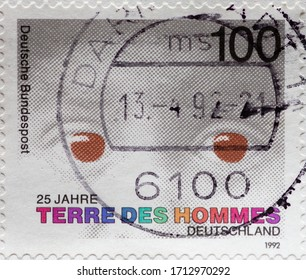 GERMANY - CIRCA 1992: a postage stamp printed in Germany showing red eyes of a child on the occasion of 25 years of aid organization terre des hommes Germany