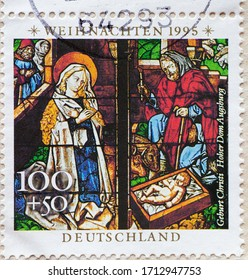 GERMANY - CIRCA 1995: a postage stamp printed in Germany showing Annunciation, details from the window of the cathedral in Augsburg. Christmas 1995