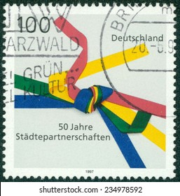 GERMANY - CIRCA 1997: Postage stamp printed in Germany, dedicated to the 50th anniversary of the Sister Cities Movement, circa 1997