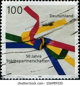 GERMANY- CIRCA 1997: A stamp printed in  German Federal Republic  shows emblem Sister Cities Movement, circa 1997