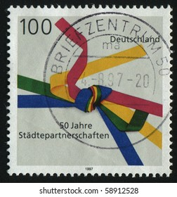 GERMANY- CIRCA 1997: stamp printed by Germany, shows emblem Sister Cities Movement, circa 1997