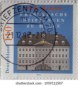 GERMANY - CIRCA 1998  : a postage stamp from Germany, showing the historic building of the social institutions Franckesche foundation zu Halle. 300th years