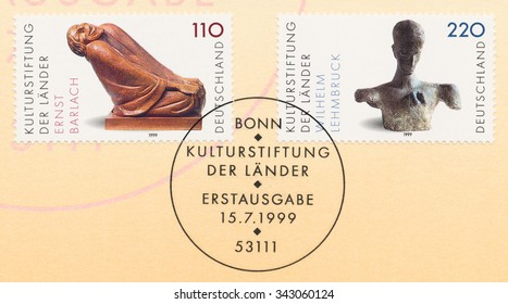 GERMANY - CIRCA 1999: A postage stamp printed in Germany, shows Old Woman Smiling, by Ernst Barlach (1870-1938), Bust of a Thinker, by Wilhelm Lehmbruck (1881-1919), Cultural Foundation, circa 1999
