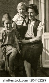 GERMANY, CIRCA TWENTIES - Vintage photo of mother with son and daughter