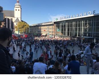 Germany, Cologne. 2018.10.15 Evacuation on Köln Hauptbusbahnhof emergency and firefighters near train station crowd run outside