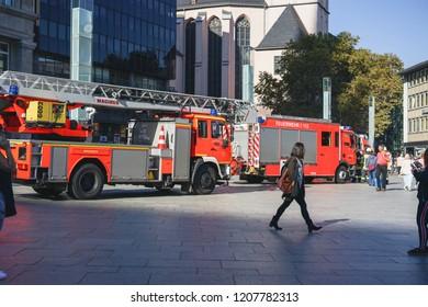 Germany, Cologne 2018.10.15 Terrorist on central train station took hostage. Fire trucks and engine on square. Terrorist attack on Köln Hauptbahnhof.