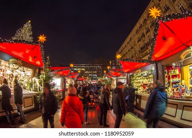 Germany, Cologne, December 2017: Christmas Maerket with people shoppign traditional gifts, buying holiday food during oldest Christmas market in the world
